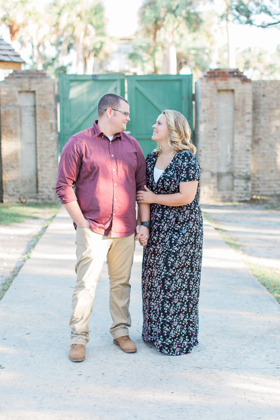 Andrew and Jaymee in front of the doors of Atalaya castle at Huntington beach state park engagement session