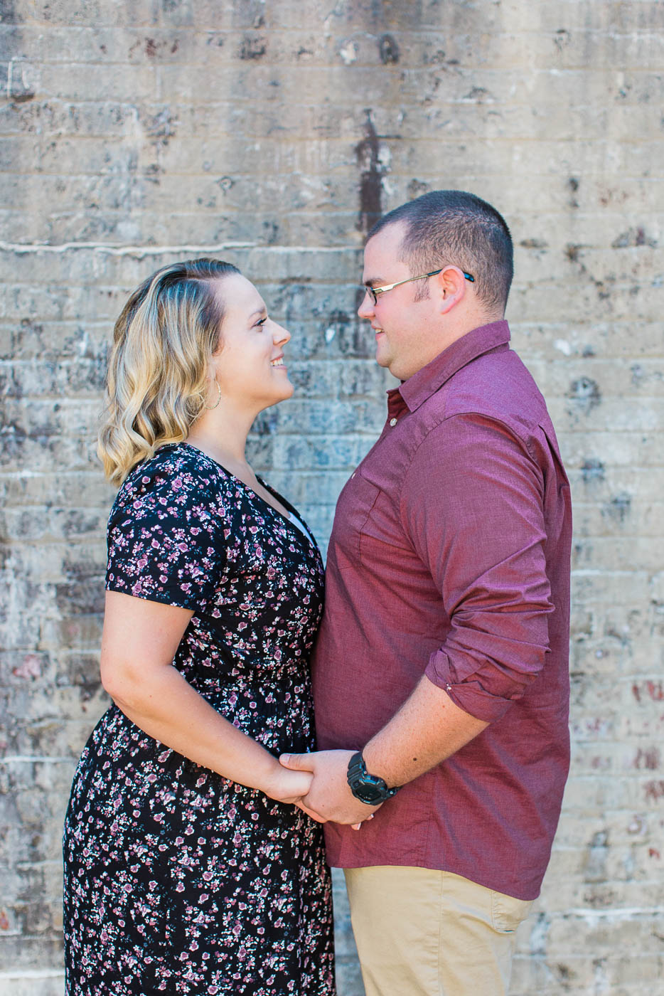 holding hands during Huntington beach state park engagement session