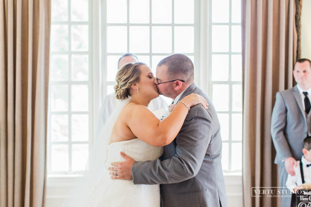 bride and groom's first kiss at Pawleys Plantation