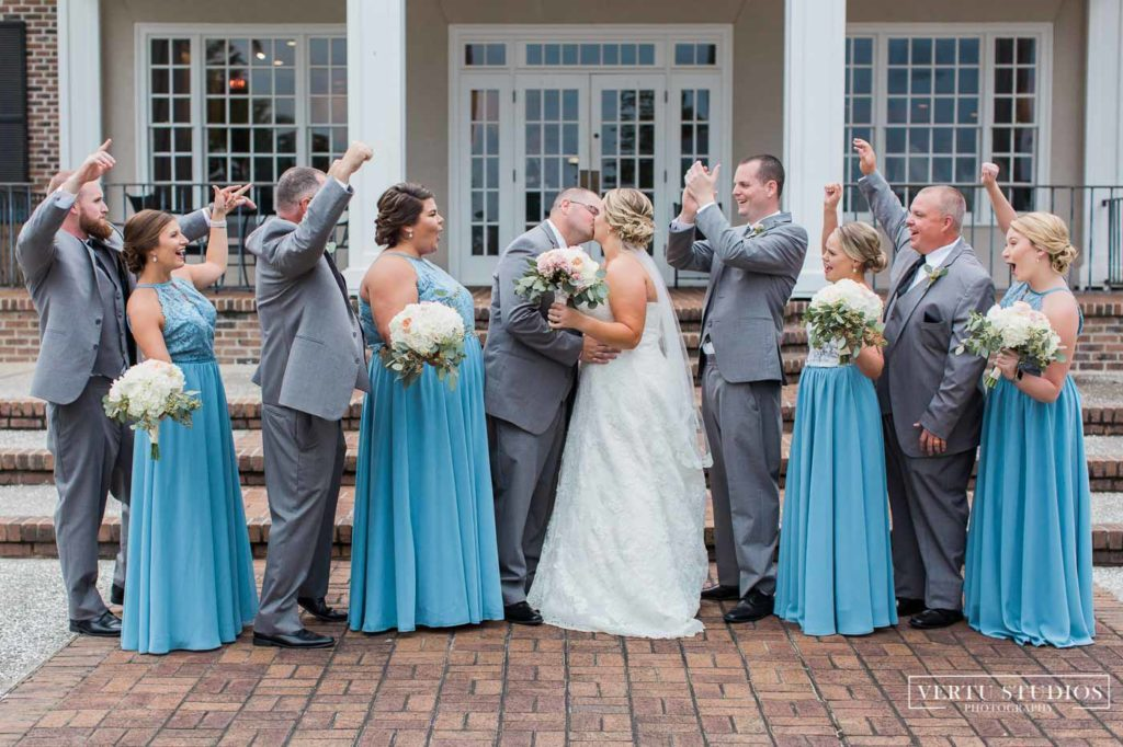 bridal party cheering bride and groom