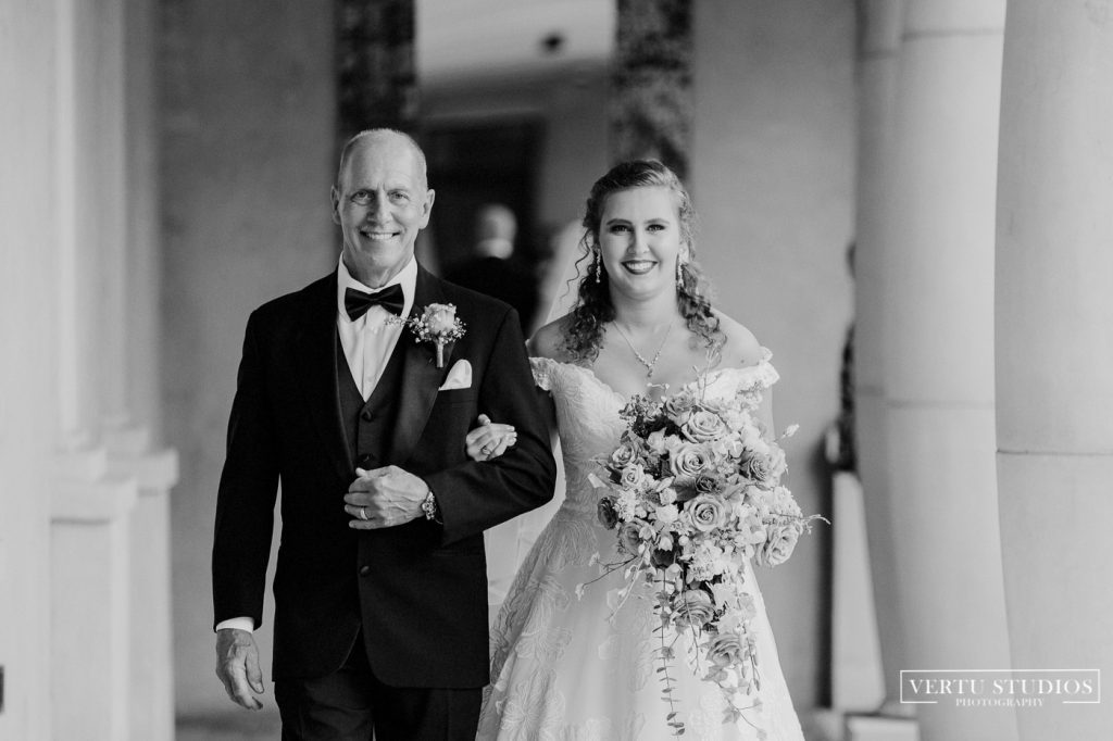 father and daughter walking down the isle at 21 Main Events at North Beach