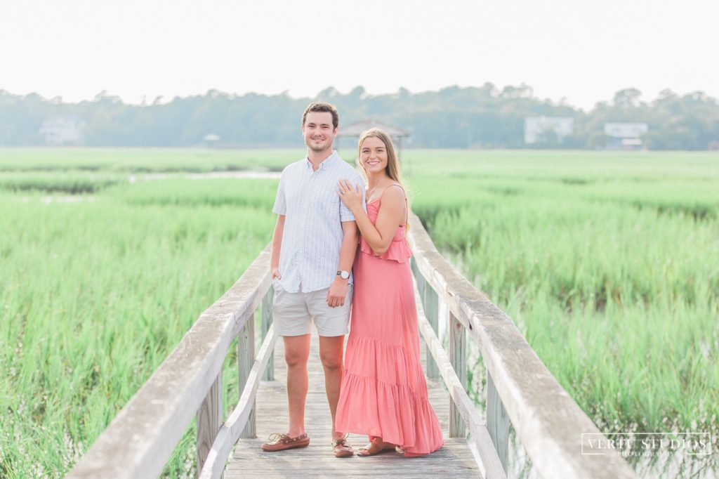 engaged couple photographed by the marsh